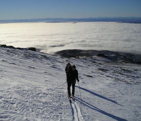 Climbing on skis high above Alex fog, click to enlarge